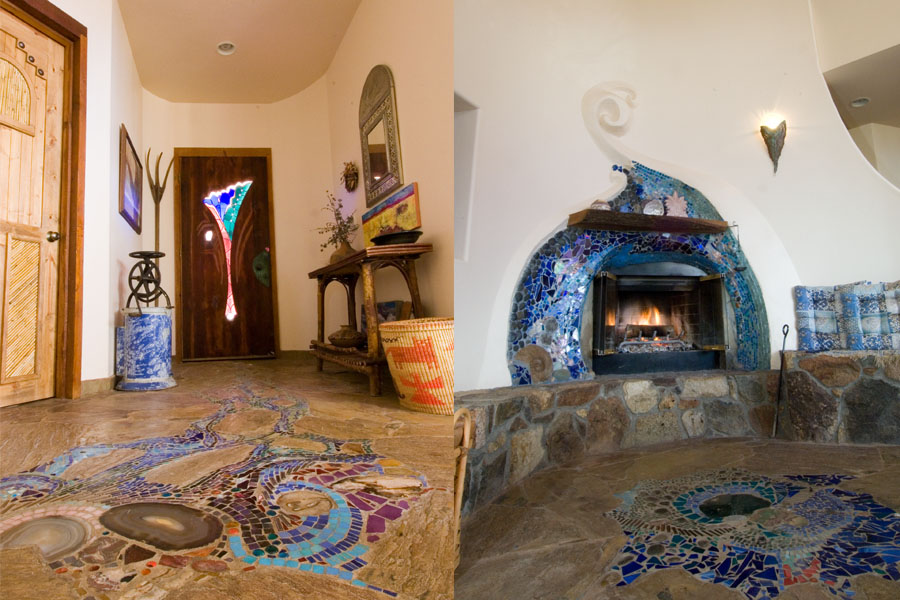 Stained glass door and fireplace with mosaics. Photo by Ryan Pennell.