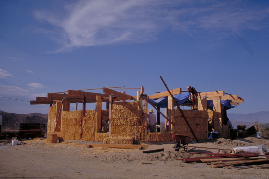 Construction photo showing straw bale walls. Photo by Drew Hubbell.
