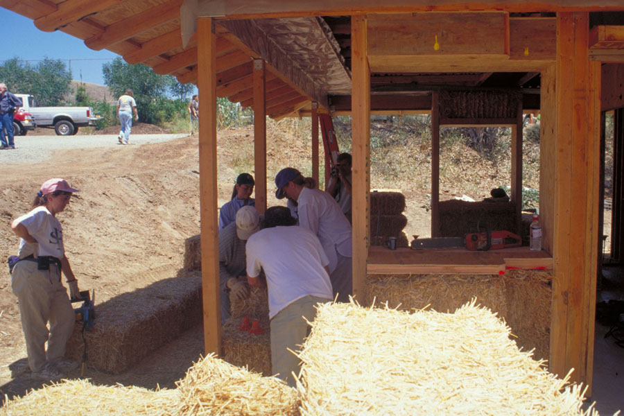 Straw bale wall raising. Photo by Drew Hubbell.