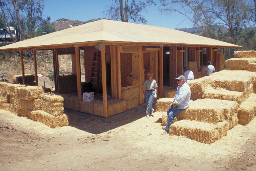 Straw bale walls under construction. Photo by Drew Hubbell.