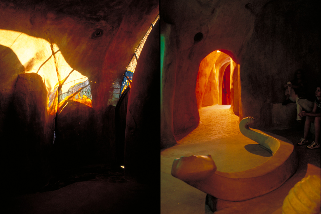 Stained glass windows letting bright light into cavern. / Sculpted theater room with serpent shaped seating.