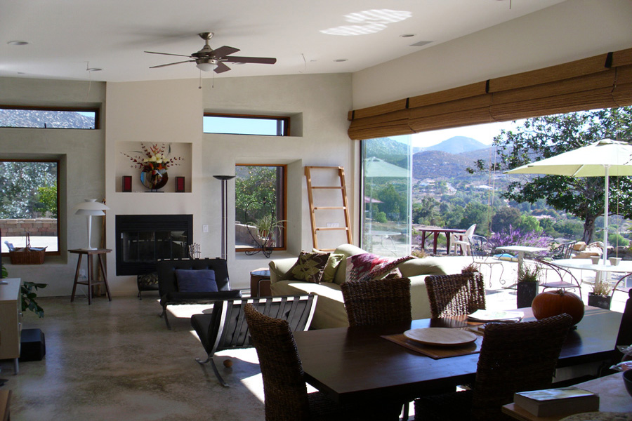 The living room opens out to the patio and mountains. Photo by Alex Miller.
