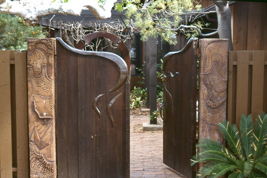 Vint Residence. Gate by James Hubbell. Ceramic posts by artist Rhoda Lopez.