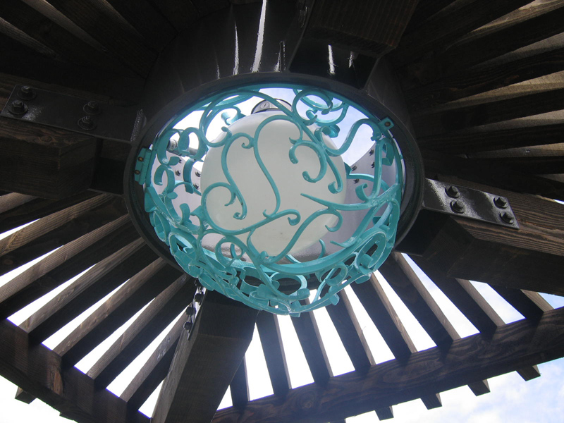 Pacific Portal. Iron decoration around overhead light.