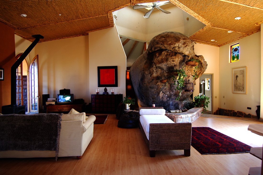 Living room with boulder and cool tower. Photo by Ryan Pennell.