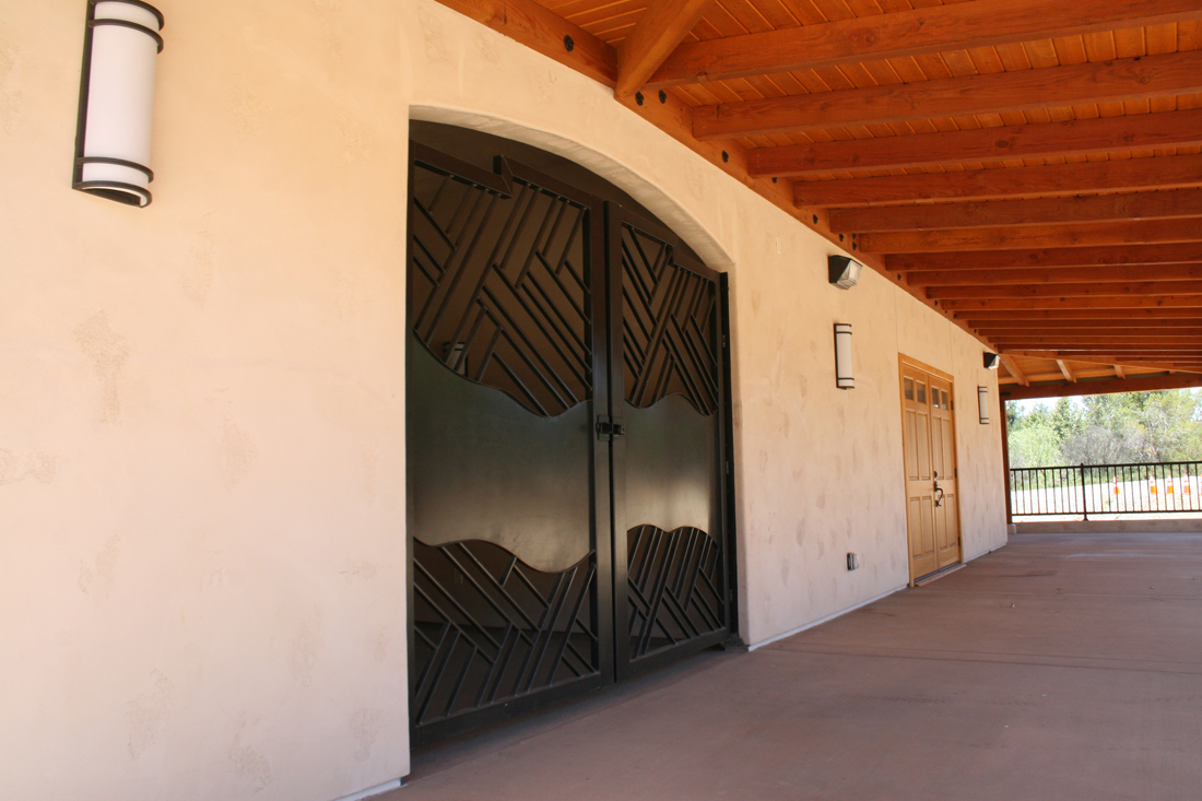 Custom gate and entry doors from front porch.